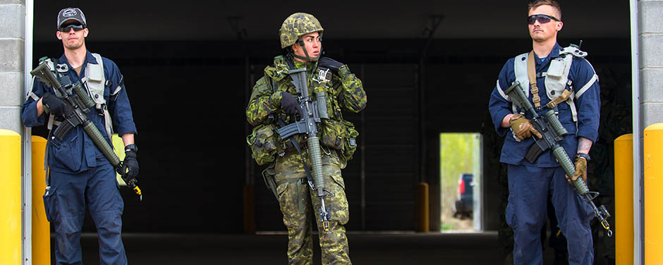 Slide - Master Corporal Ghazzaoui of the Canadian Grenadier Guards provides security