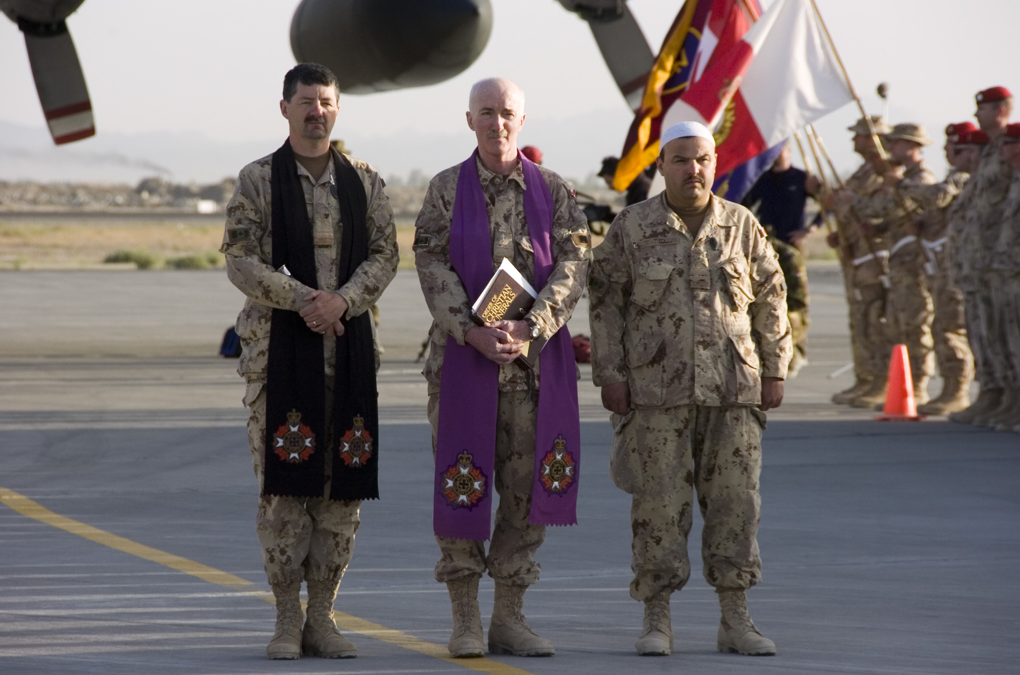 Photo of  a religious service conducted on 24 April 2006 in Kandahar, Afghanistan by a Canadian Armed Forces chaplain