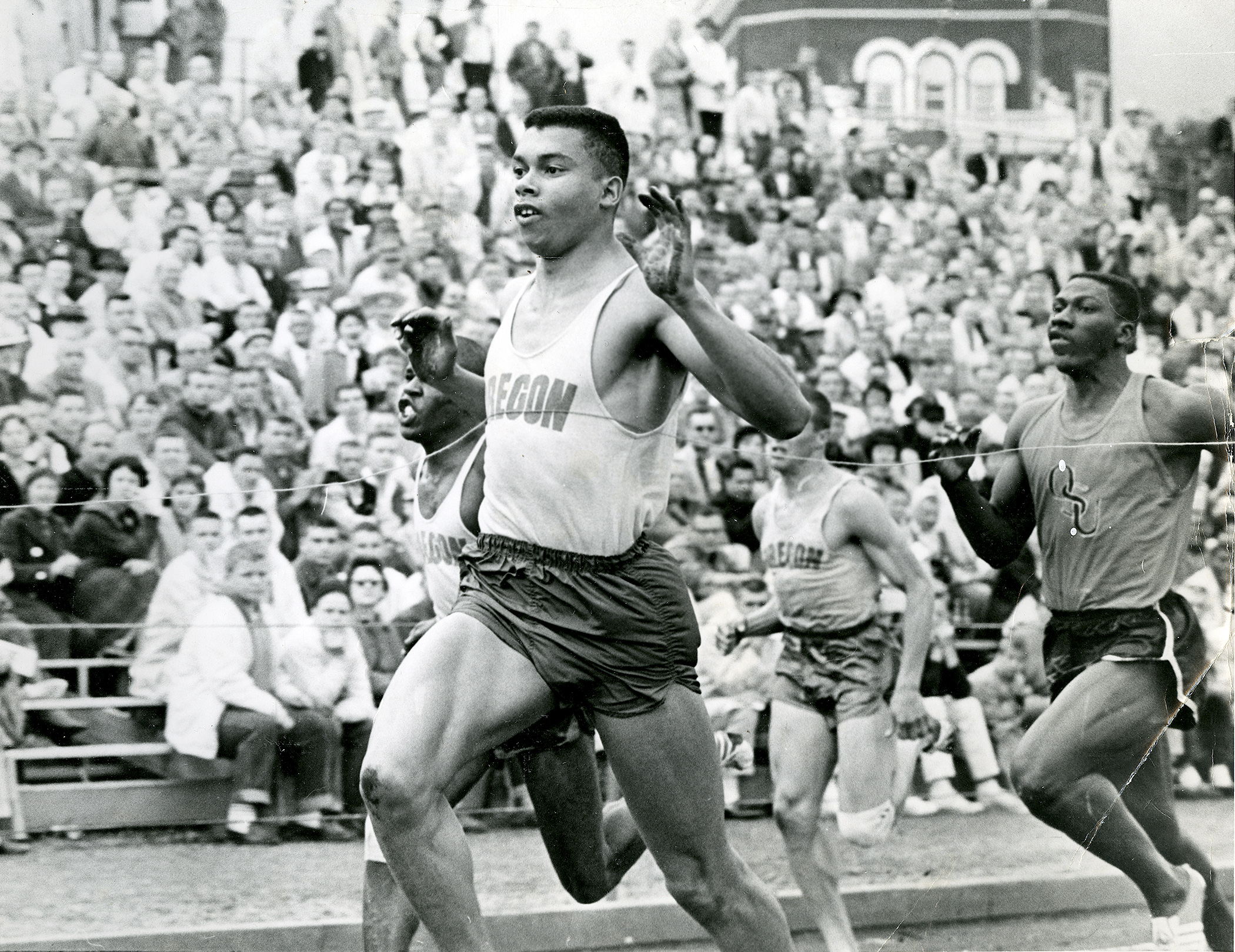 Harry Jerome crosses the finish line at a dual meet with the University of Oregon and Oregon State University, circa 1961. Mr. Jerome competed in the United States for four years and had multiple American Athletic Union and National Collegiate Athletic Association wins while a scholarship student at the University of Oregon. Photo credit: Harry and Valerie Jerome fonds, Simon Fraser University Special Collections and Rare Books Division.