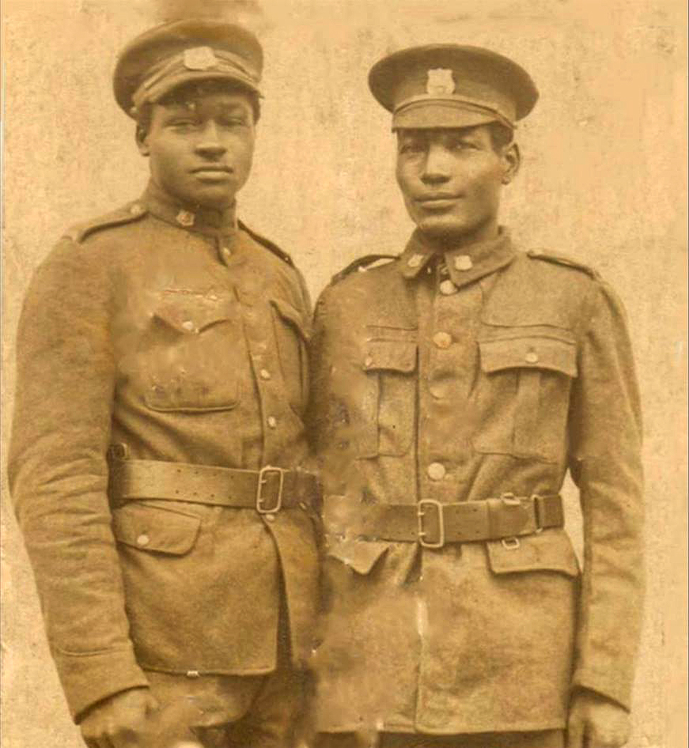 An antique black and white photograph of two black soldiers in uniform