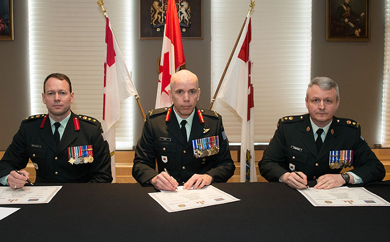 Left to right, Outgoing Commander 3 CDSG Colonel Derek Macaulay, 3rd Division Commander, Brigadier-General Wayne Eyre, and incoming Commander 3 CDSG Lieutenant-Colonel Robert Thompson.