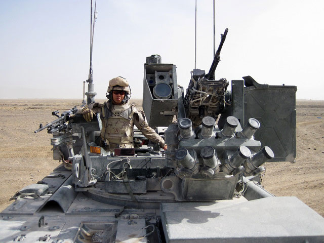 Master Corporal Cherith Tse commanding the crew of a Light Armoured Vehicle (LAV) on combat logistics patrol in Kandahar, Afghanistan in 2010.