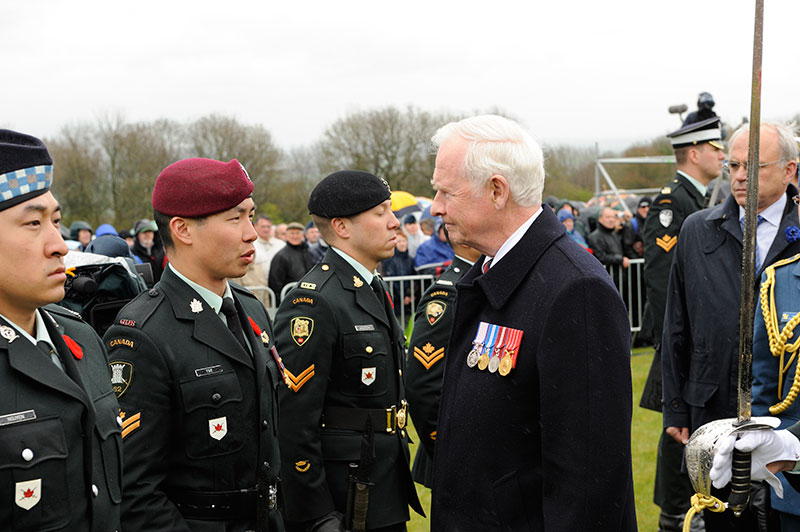 His Excellency the Right Honourable David Johnston (centre) speaks with Corporal Cherith Tse, a member of the guard, while inspecting the troops during the main commemorative ceremony for the 95th Anniversary of the Battle of Vimy Ridge at the Canadian National Vimy Memorial in Vimy, France on April 9, 2012.