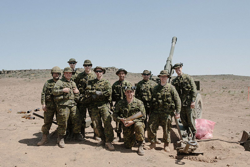 "Warrant Officer Smith poses with members of ""C"" Detachment from the 15th Field Artillery Regiment, RCA. Photo: Bombardier Albert Law"