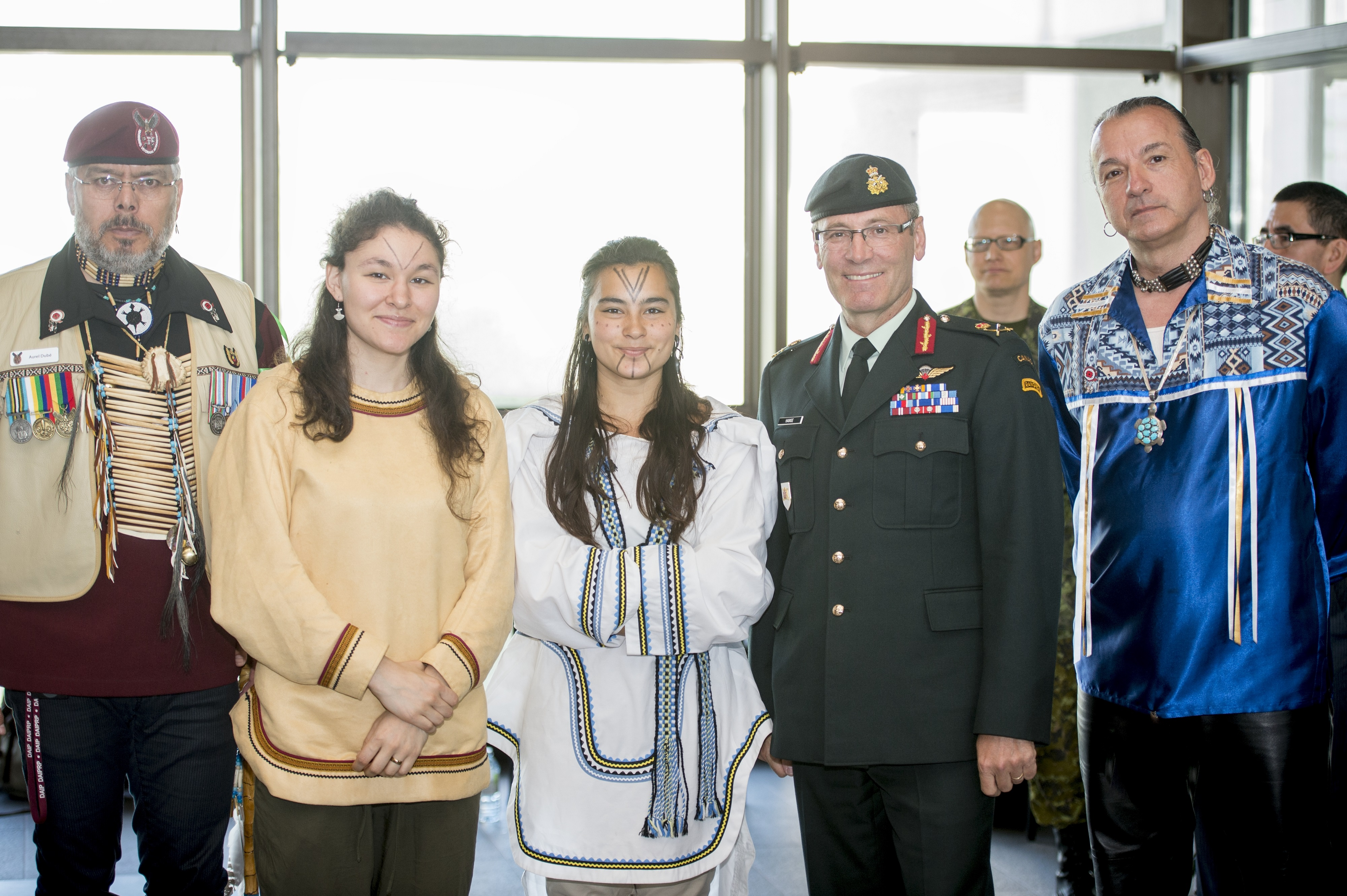 Lieutenant-General Marquis Hainse, Commander of the Canadian Army, is shown with participants of the 2015 Aboriginal Awareness Week ceremony held in the main concourse of National Defence Headquarters in Ottawa, Ontario, on May 19. Photo by: Cpl Andrew Wesley.