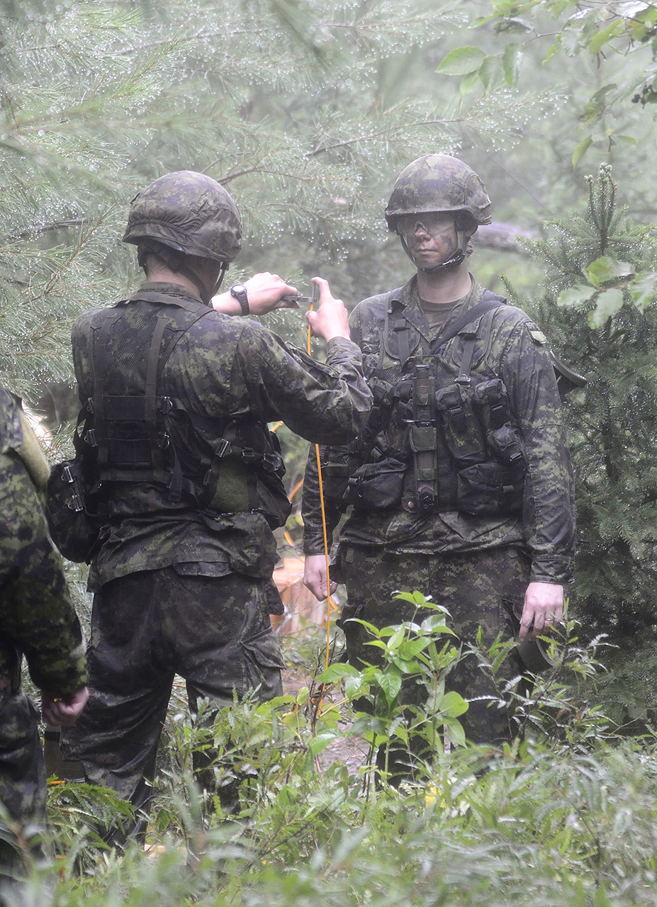 Sapper John Hiebert and Master Corporal Tracy Pembleton of 31 Combat Engineer Regiment (The Elgin's) prepare the Manufactured Charges (Beehives) for detonation during Exercise STALWART GUARDIAN on August 20, 2015 at Garrison Petawawa, ON.