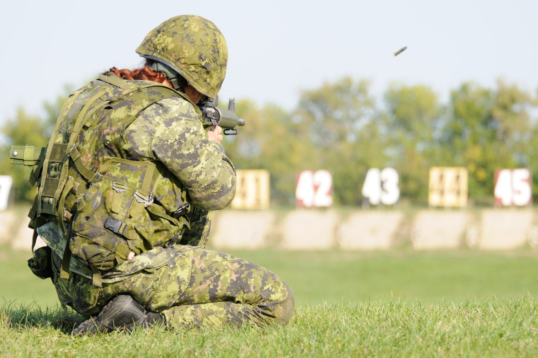 September 13, 2012 - Competitor Master Corporal Tatyana Danlyshyn, with the Princess Louise Fusiliers, competes during the rifle portion of the Canadian Forces Skills Arms Competition (CFSAC). Every September, Canadian Forces, Royal Canadian Mounted Police and international top shots gather at Connaught Range in Ottawa for the annual Canadian Forces Small Arms Concentration. This international skill at arms competition has been designed to test all components of the Canadian Forces in operational marksmanship with a service rifle, service pistol and light machine gun. All participants compete for the prestigious Queen's Medal for Champion Shot and a chance to represent the Canadian Forces at the British Army's Central Skill at Arms Meeting in England. Photo by: Sgt Veronica Arsenault, Army Public Affairs. © 2012 DND-MDN Canada