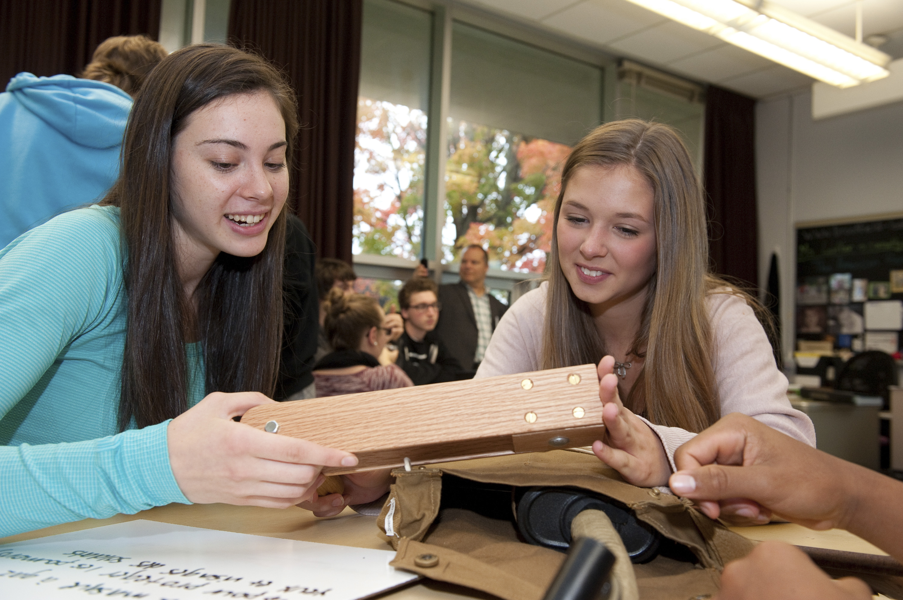 Students examine a gas alarm rattle, one of the artifacts found in the Canadian War Museum's Supply Line First World War Discovery Box.