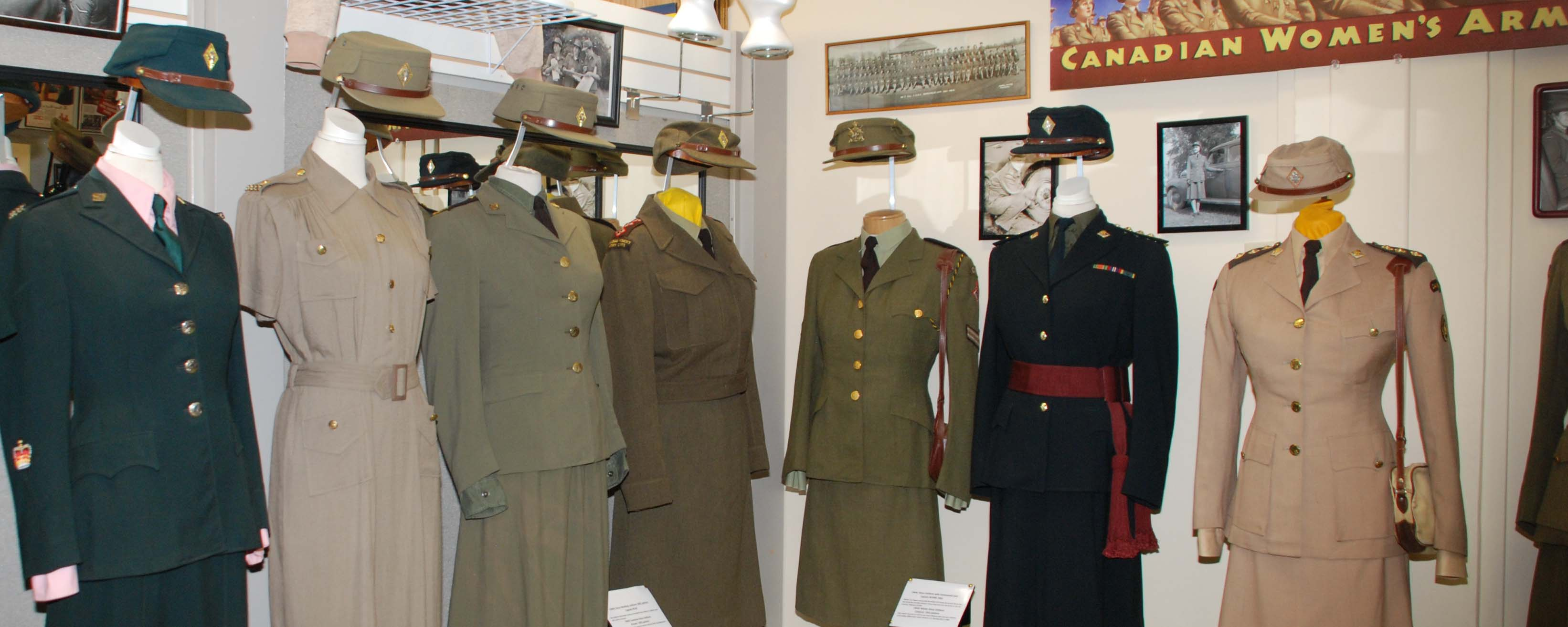 A museum display of seven examples of Canadian female military uniforms from various points in history
