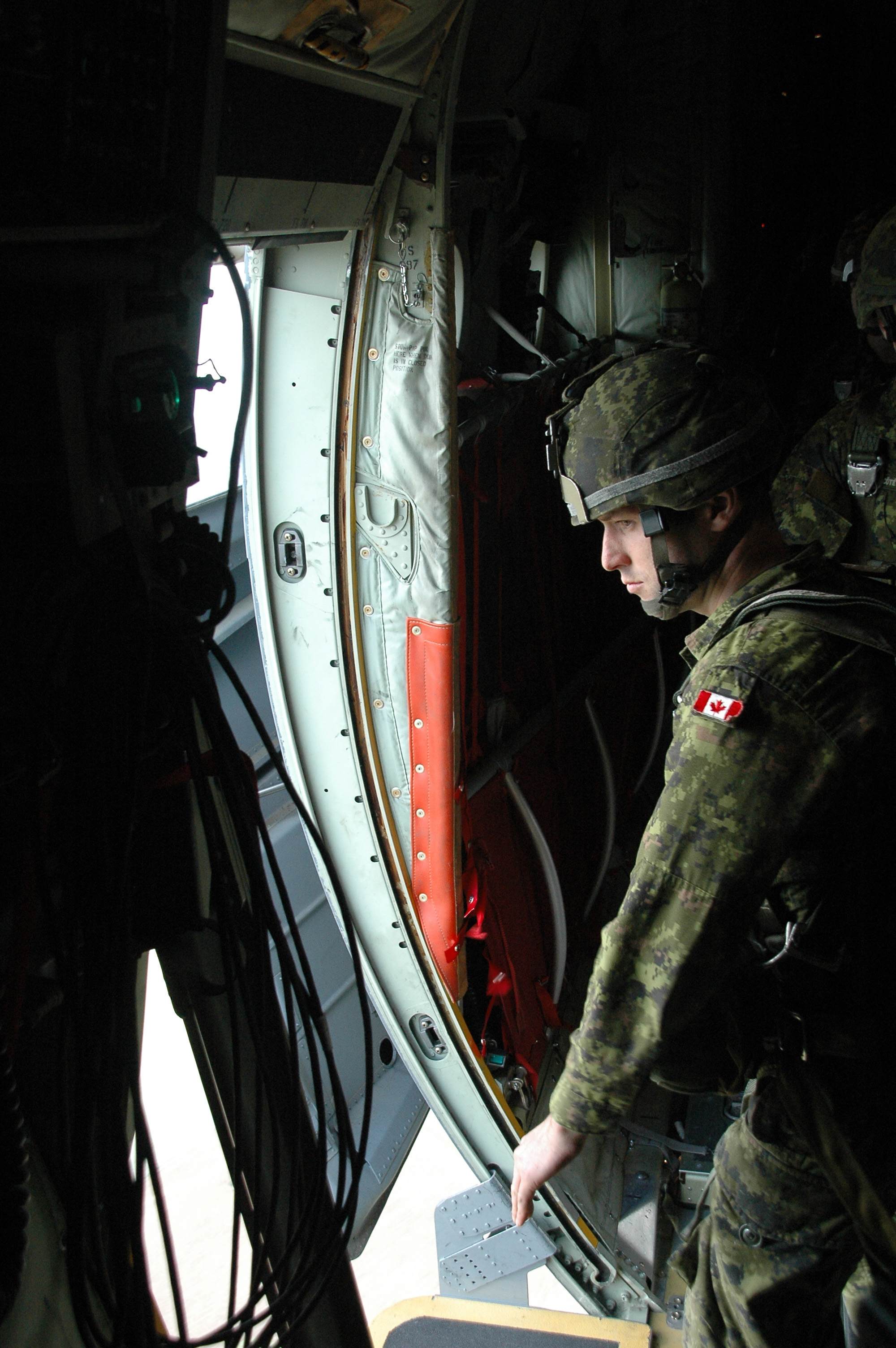 Members of the Canadian Army prepare to jump during a mass NATO paradrop at Santarém, Portugal on October 28, 2015 during Exercise TRIDENT JUNCTURE 15. Photo by: Sold Ferraz, Public Affairs Officer - Santa Margarida LOPSCON.