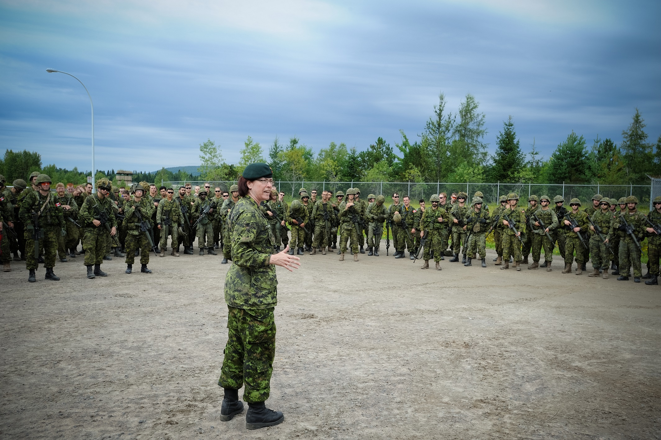 Colonel Josée Robidoux, Commander of 35 Canadian Brigade Group, addresses a large group of 34 Canadian Brigade Group members who had just completed a 13-kilometre march on August 16, 2015 in Valcartier, Quebec during Exercise NOBLE GUERRIER 2015. Photo by: Master Corporal Valérie Villeneuve ©2015 DND-MDN Canada.
