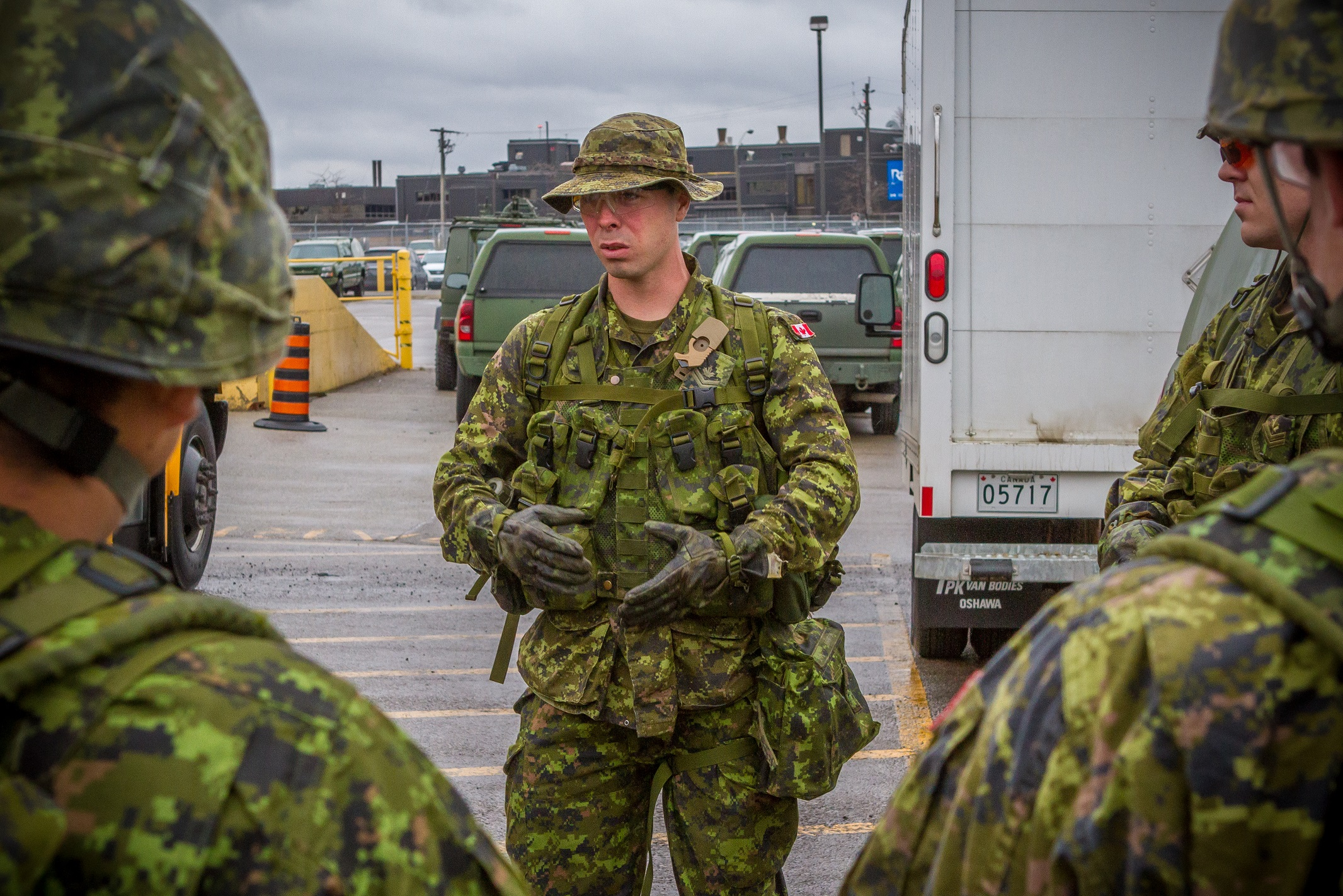 Master Corporal Tyler Brunton (Queens York Rangers) shares his experiences with procedures for vehicle checkpoints as part of Operation PROVISION. Photo by: Corporal Justin Dreimanis, 32 CBG PA.