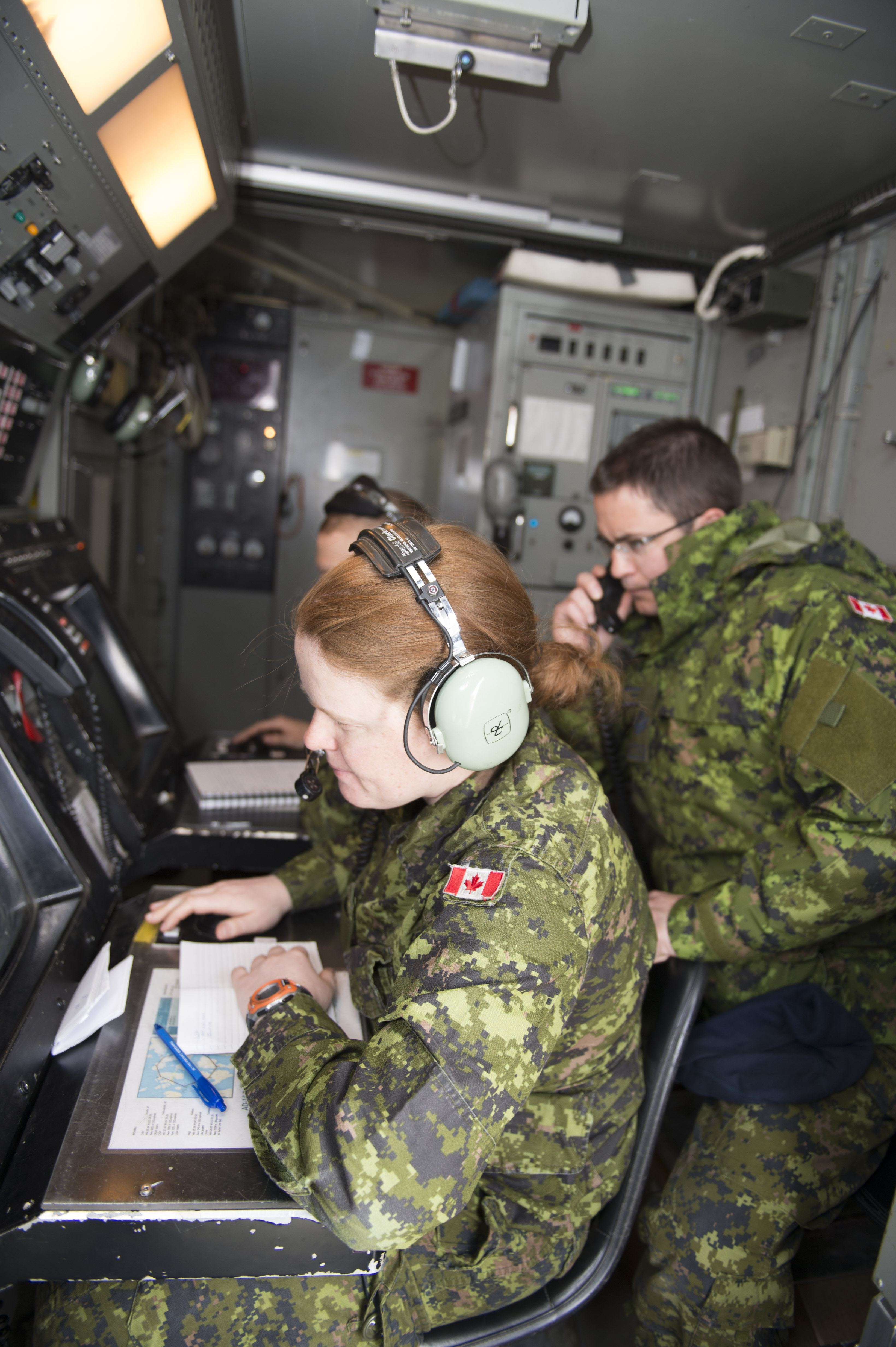 An Aerospace Controller watches the control radar screen while an Air Control Operator relays information during Exercise AMALGAM DART 15-2.