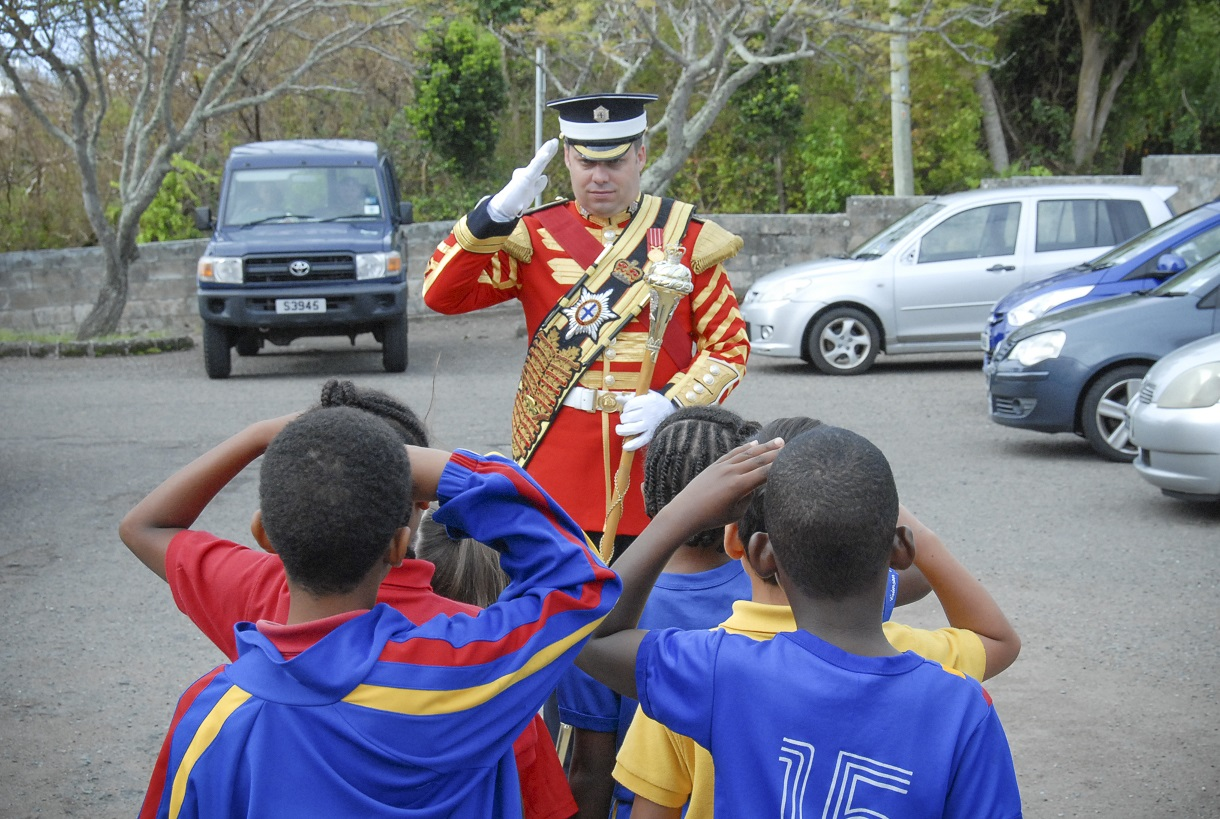 School children at Purvis Primary School in Warwick, Bermuda participate in a fun drill lesson with Governor General's Foot Guards Drum Major, Colour Sergeant Stéphane Marleau. The Regimental Band of the Governor General's Foot Guards was in Bermuda from 18 – 25 October to participate in the 2015 Bermuda Tattoo and to celebrate the 50th Anniversary of the Royal Bermuda Regiment. Photo by:  Sergeant Rob McKinnon, Army Public Affairs.