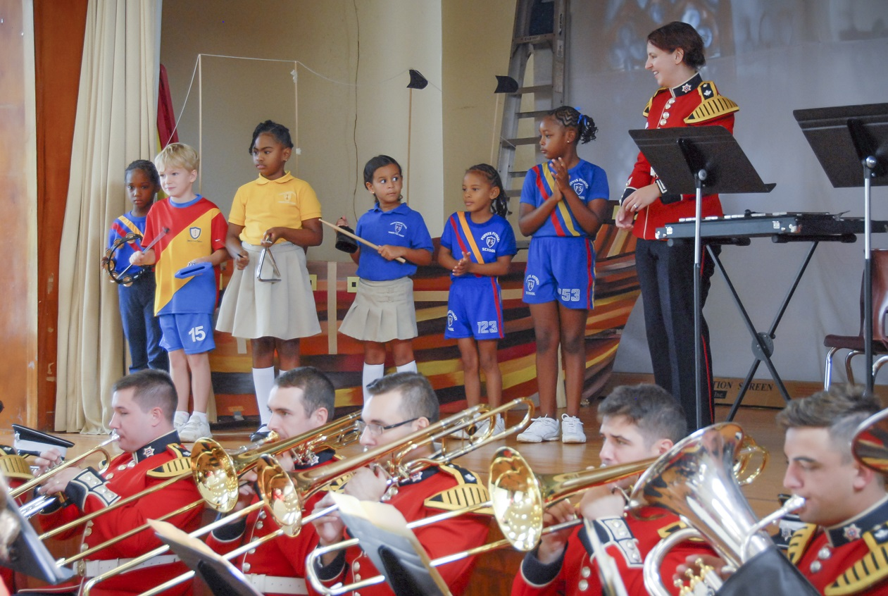 Some of the children from Purvis Primary School in Warwick, Bermuda were invited to perform on colour percussion instruments with the Regimental Band of the Governor General's Foot Guards during a morning concert. The Regimental Band of the Governor General's Foot Guards was in Bermuda from 18 – 25 October to participate in the 2015 Bermuda Tattoo and to celebrate the 50th Anniversary of the Royal Bermuda Regiment. Photo by:  Sergeant Rob McKinnon, Army Public Affairs.