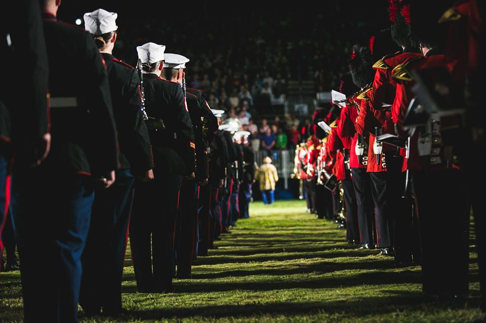 Musicians from the Governor General's Foot Guards and The United States Marine Corps' 2nd Marine Craft Wing Band stand at attention in perfect formation.