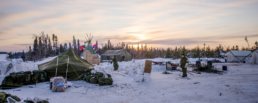 slide - The sun is setting at the 2nd Regiment, Royal Canadian Horse Artillery headquarters command post at Camp Kawach, in Northern Ontario during Operation TRILLIUM RESPONSE on February 12, 2016.