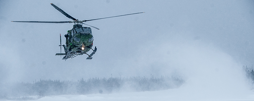 slide - A CH-146 Griffon from 438 Squadron sets down during a mission in Round Lake, ON in support of Operation TRILLIUM RESPONSE 2016 on February 17, 2016.