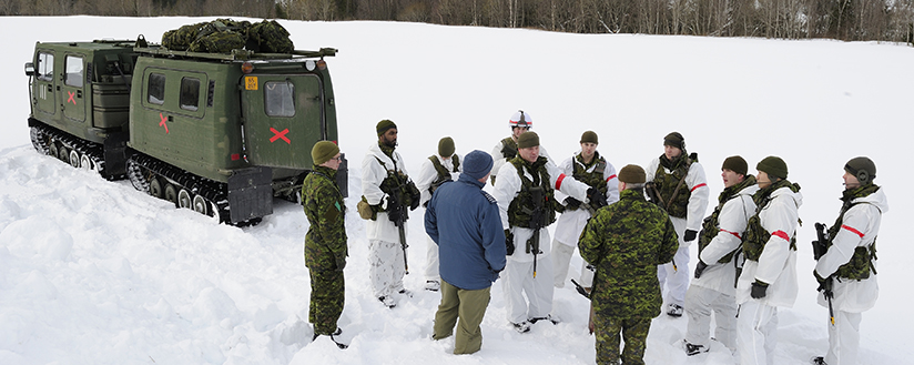 slide - Members for 3rd Battalion, Royal Canadian Regiment, are being briefed beside a BV 206 Tracked Carrier at Namsos, Norway, as part of a Canadian-led multinational Battle Group on Exercise COLD RESPONSE 2016.