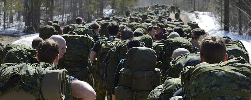 slide - Soldiers of 2 Canadian Mechanized Brigade Group participate in Exercise Rucking Bear, a 20 kilometre march through Garrison Petawawa and training area on April 15, 2016.