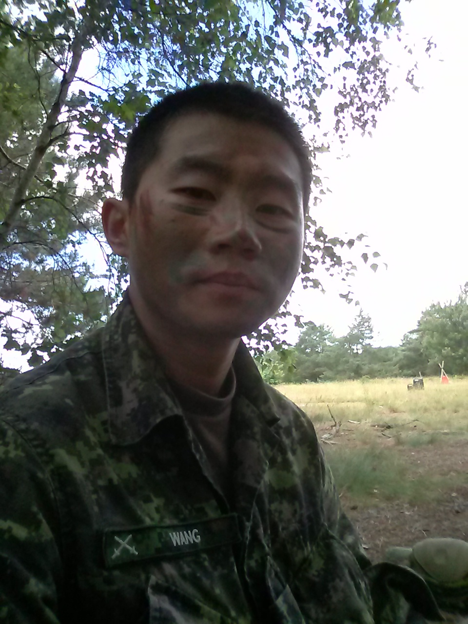 "Second Lieutenant Rui Hao Wang during a break from offensive/defensive training in Officer Phase 2 level of basic training at Camp Aldershot in July 2015. ""Break time was also known as selfie time. I was so tired, and I wanted to document how tired I was,"" he said.