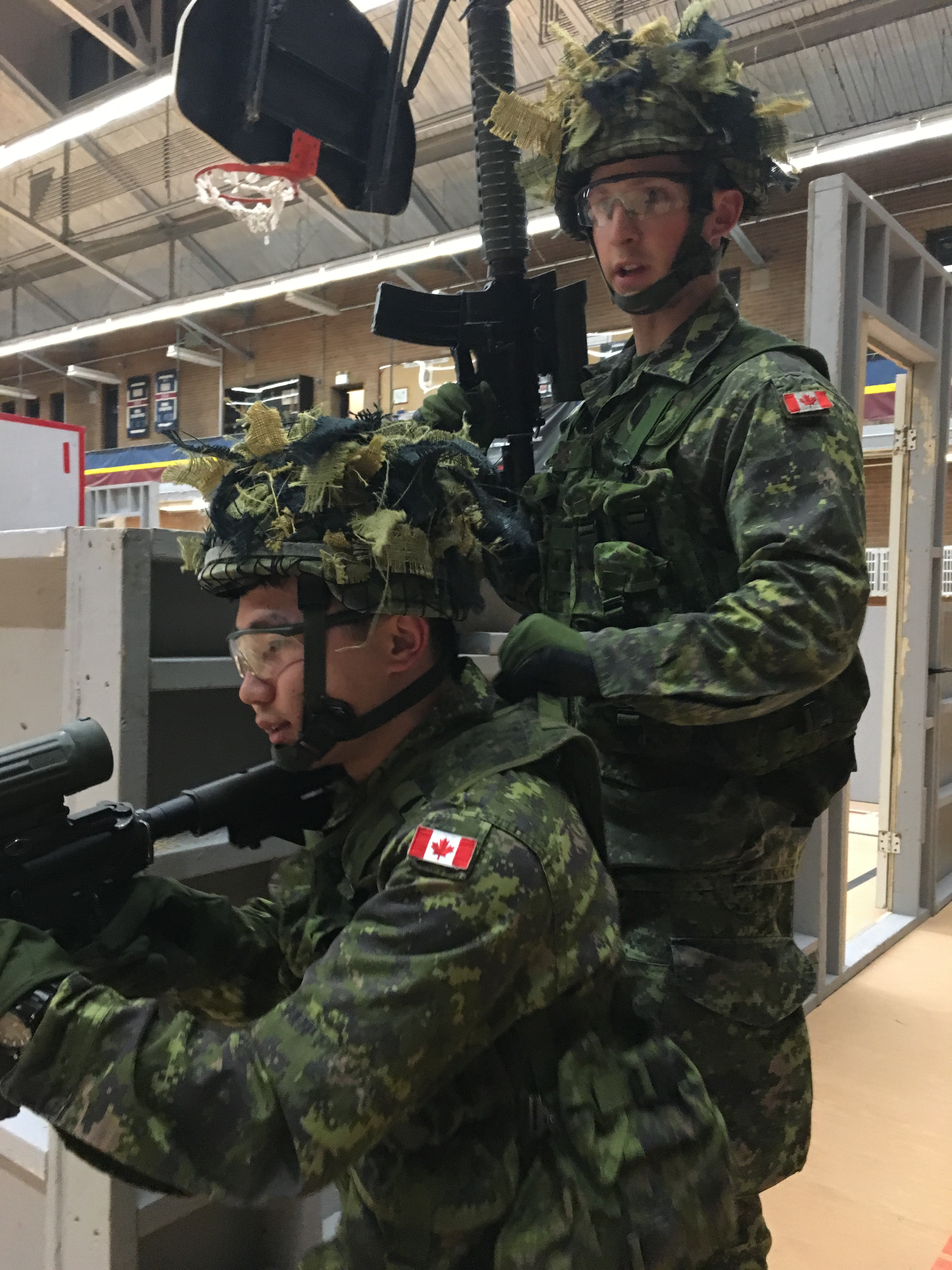 Second Lieutenant Rui Hao Wang, taking point with another soldier during Close Quarter Battle (CQB) training during part of the Regimental Indoctrination Course at the Royal Montreal Regiment (RMR) in March 2016.