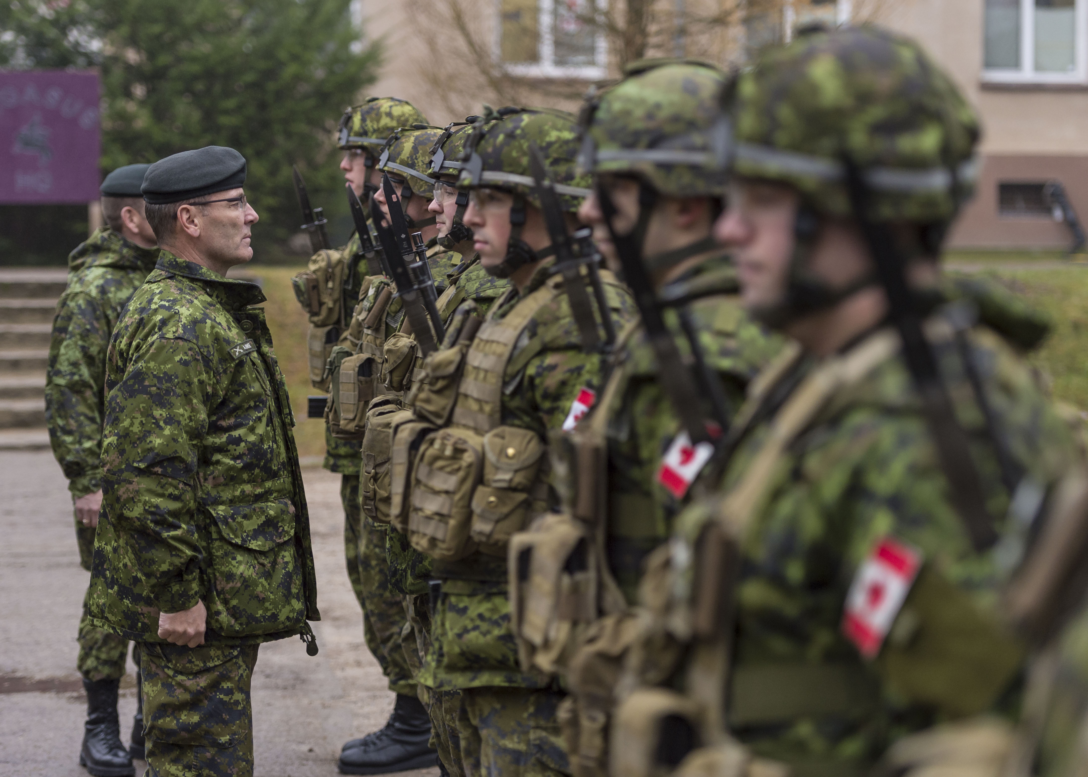 Lieutenant-General Marquis Hainse, Commander Canadian Army, inspects the troops during a visit to Glebokie, Poland on December 16, 2015 during Operation REASSURANCE. LGen Hainse said this week he welcomes recommendations from the Auditor General of Canada on ways to improve how the Army Reserve is funded, recruited, trained, and equipped.