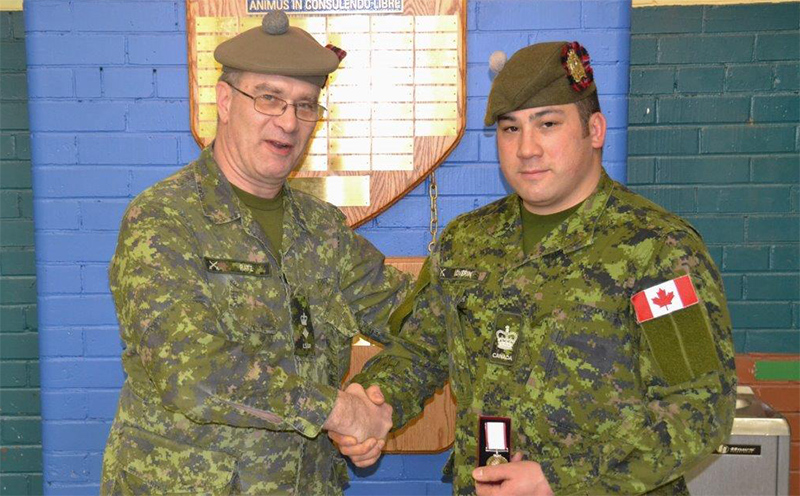 Warrant Officer Craig Loverin receives medal