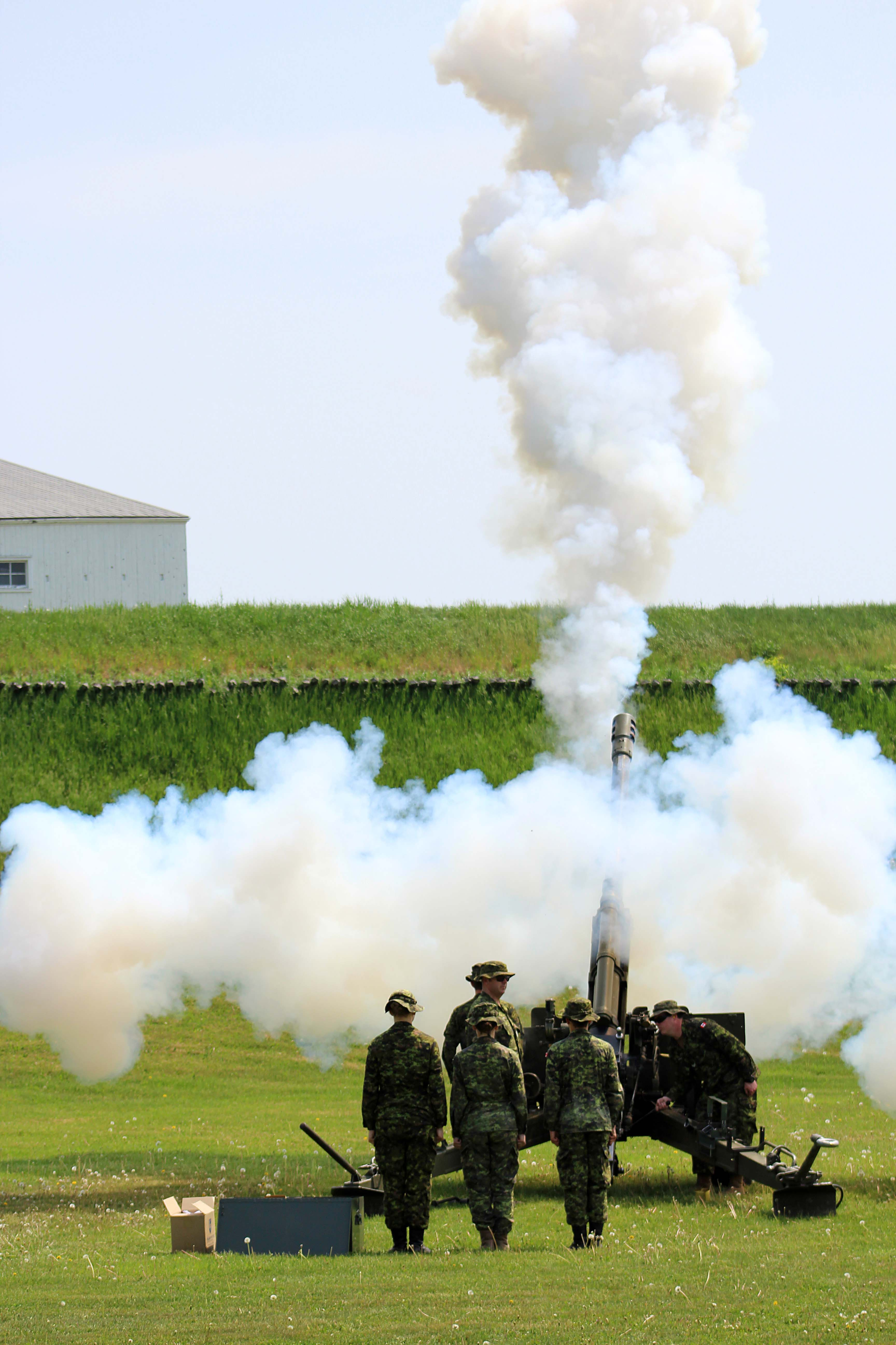 Members of the 30th Field Artillery Regiment RCA fire the C3 105mm Howitzer after a moment of silence at Fort Wellington National Historic Site. The soldiers also fired a 19th century cannon at Fort Wellington, Ontario on May 28, after a cenotaph ceremony commemorating the Fenian Raids.