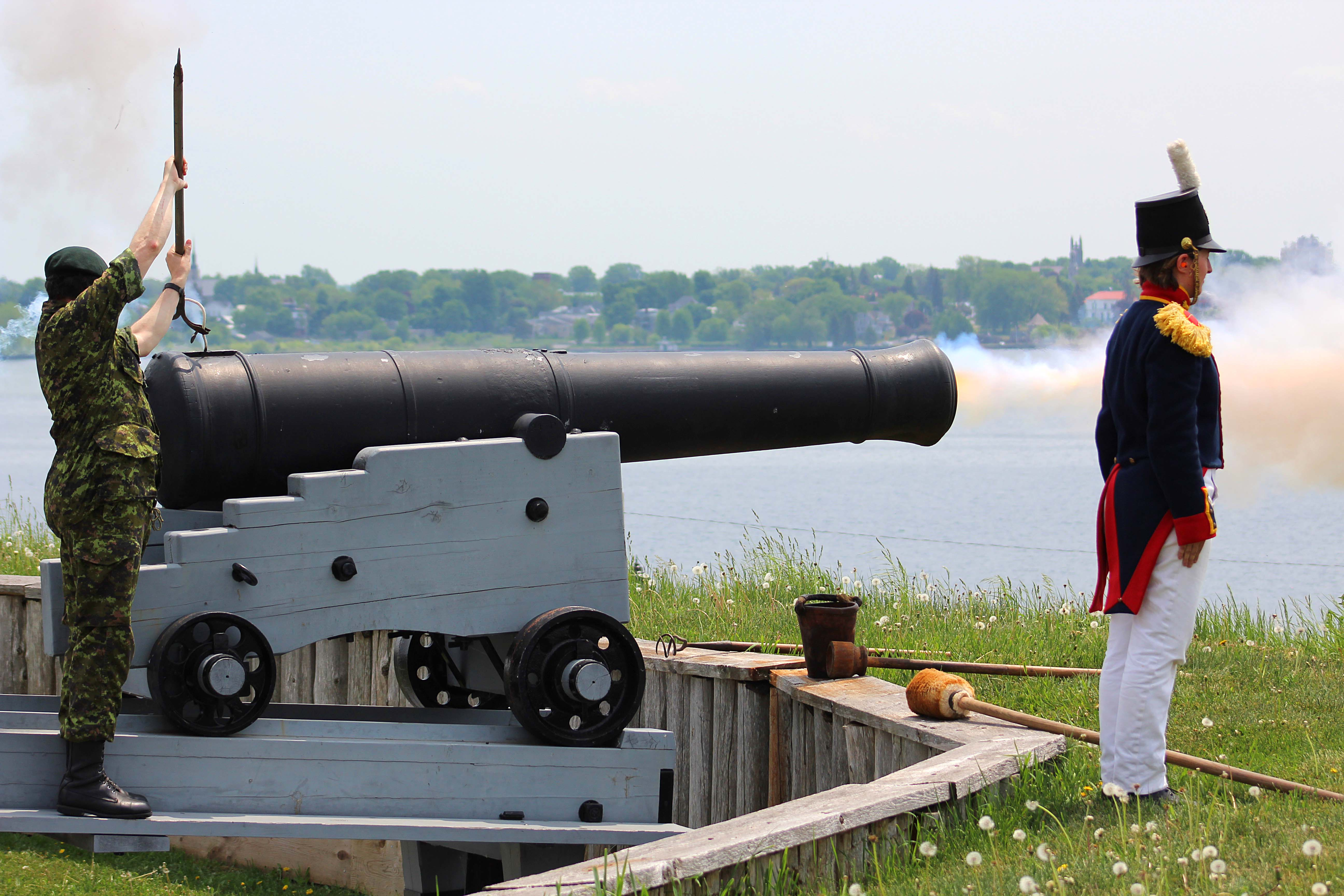 Brigadier General James Selbie, Colonel Commandant of the Royal Regiment of Canadian Artillery fires the 19th century muzzle-loading cannon on the ramparts of Fort Wellington National Historic Site on May 28 at a ceremony commemorating the Fenian Raids. BGen Selbie, as the Col Comdt, is the representative of all serving and retired Gunners to the Captain General: Her Majesty, Queen Elizabeth II.