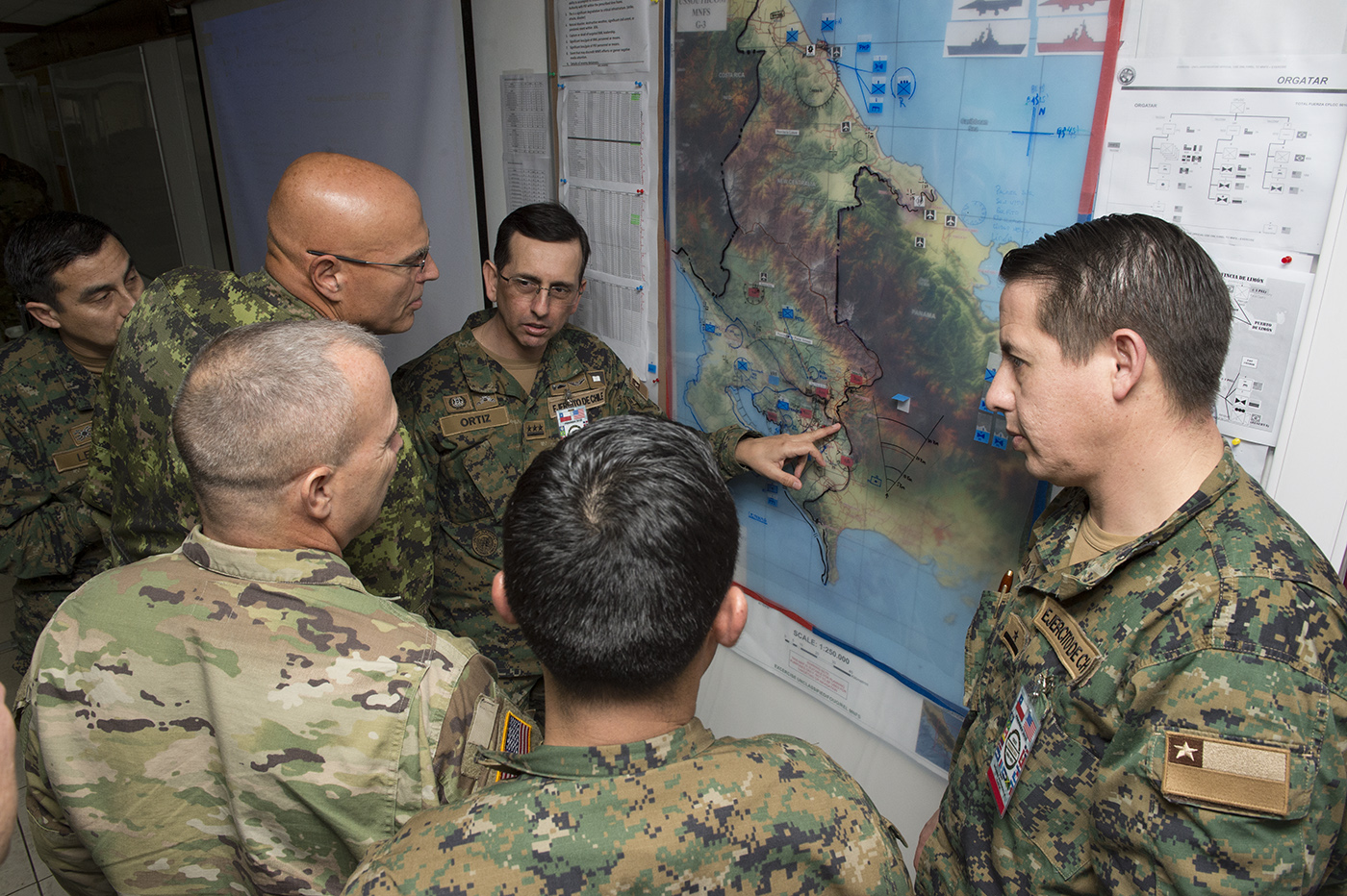 Soldiers discusing strategy and referring to a map