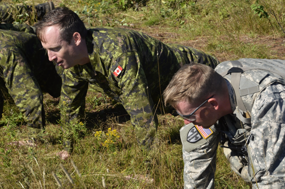 An American MP joins Canadians in the 22 Push-Ups, 22 Days challenge in the field at Base Gagetown, N.B., during Ex STRIDENT TRACER 16 on August 23, 2016. Photo: Lt Felix Odartey-Wellington