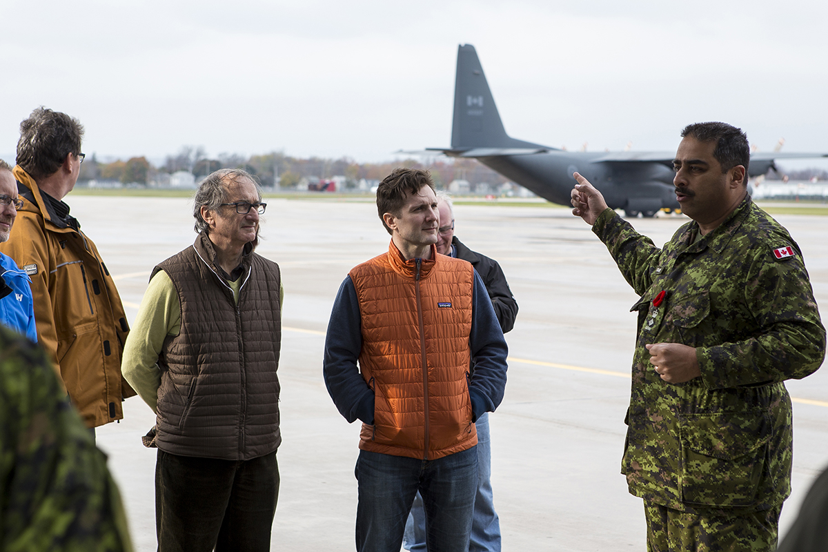 Lieutenant-Colonel Sandi Banerjee, the Commanding Officer of the Queens Own Rifles explains paratrooper operations to Participants of the Executrek Program at the Canadian Army Advanced Warfare Centre in Canadian Forces Base Trentono n October 29, 2016