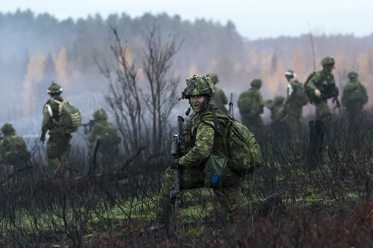 Soldiers from November Company of the 3rd Battalion of the Royal Canadian Regiment (3 RCR) conduct a Company sized attack on the objective during Exercise Storming Bear on 3rd November 2016, at 4th Canadian Division Support Base Petawawa, Ontario.