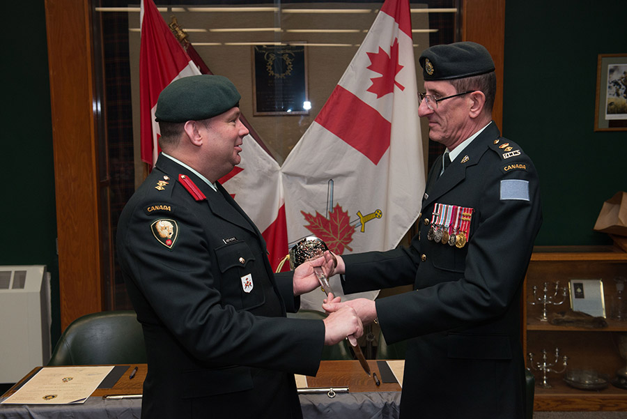 Lieutenant Colonel John Groves, pictured right, hands the 38 Signal Regiment's Commanding Officer's ceremonial sword to Colonel Geoffrey Abthorpe at a Change of Command Ceremony in Winnipeg on Jan. 14. Groves has stepped down as the Commanding Officer of 38 Signal Regiment to become the new Deputy Brigade Commander of 38 Canadian Brigade Group.