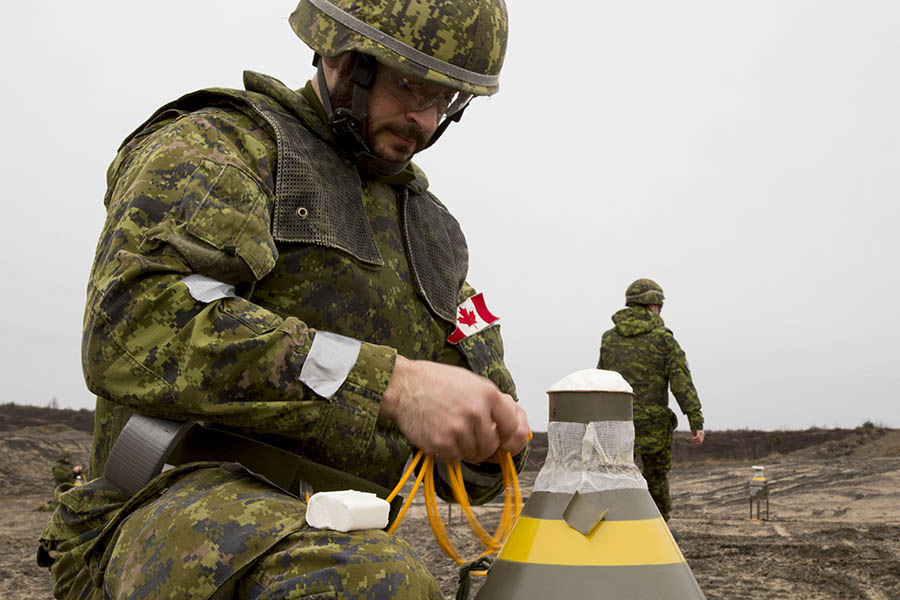 A Canadian Army (CA) Combat Engineer prepares an explosive device as part of Operation REASSURANCE in Poland on March 30, 2016. Many Army Warrant Officers with backgrounds in engineering and other technical trades have benefitted from the additional skills they gain in the Army Technical Warrant Officer Program.
