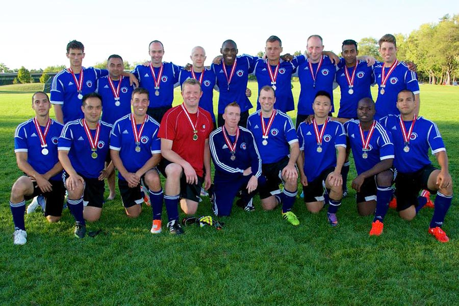 Corporal Jean-Marc Hannelas (back row, second from right), Manager of the 22 Wing/Canadian Forces Base North Bay men's soccer team on September 22, 2015 in Borden Ontario. He was drafted by the Canadian Forces Base Trenton team to represent Ontario in the national championships. The team won second place.