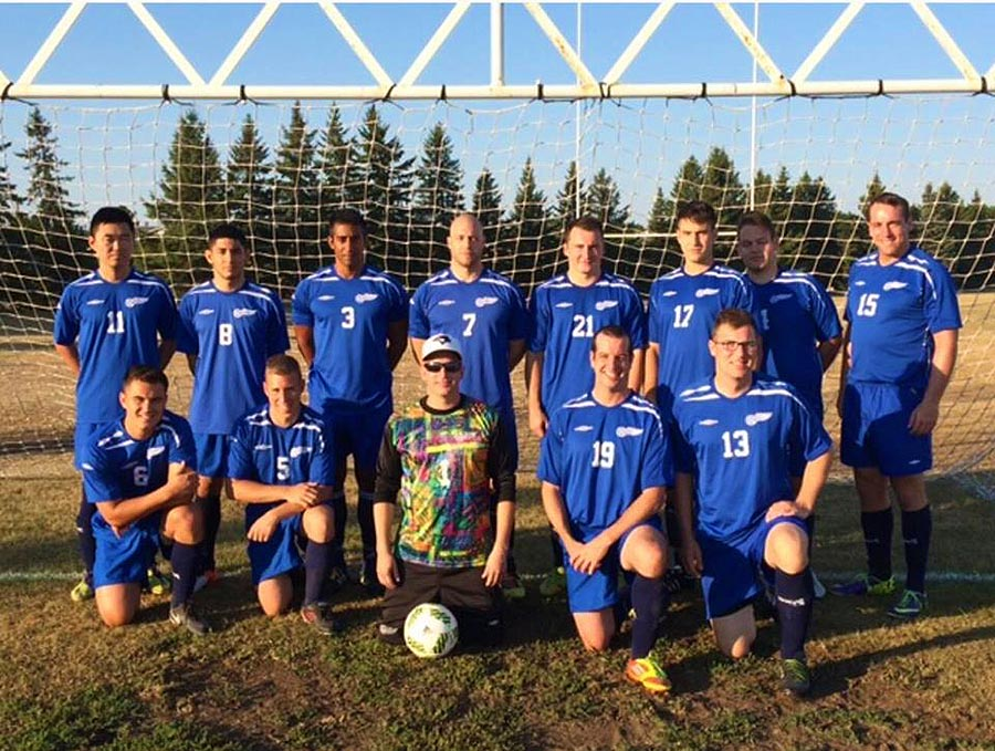 Corporal Jean-Marc Hannelas (back row, third from left), Manager of the 22 Wing/Canadian Forces Base North Bay men's soccer team on August 9, 2016 in Petawawa, Ontario.