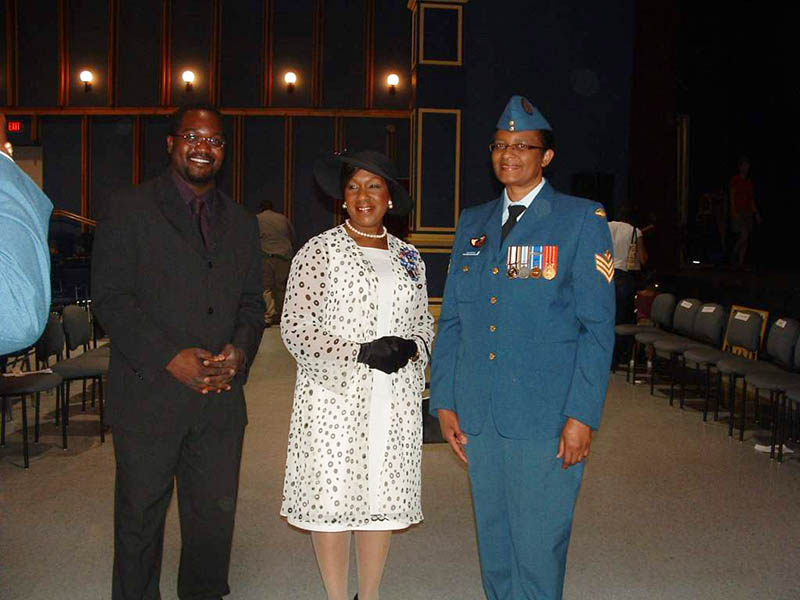 Sergeant Joan Buchanan, now retired, Military Co-Chair of the Defence Visible Minorities Advisory Group Atlantic Region with Civilian Co-chair Henri-Thierry de Souza and then- Lieutenant-Governor of Nova Scotia the Honourable Mayann Francis in July 2009 at the # 2 Construction Battalion Ceremony in Halifax, Nova Scotia.