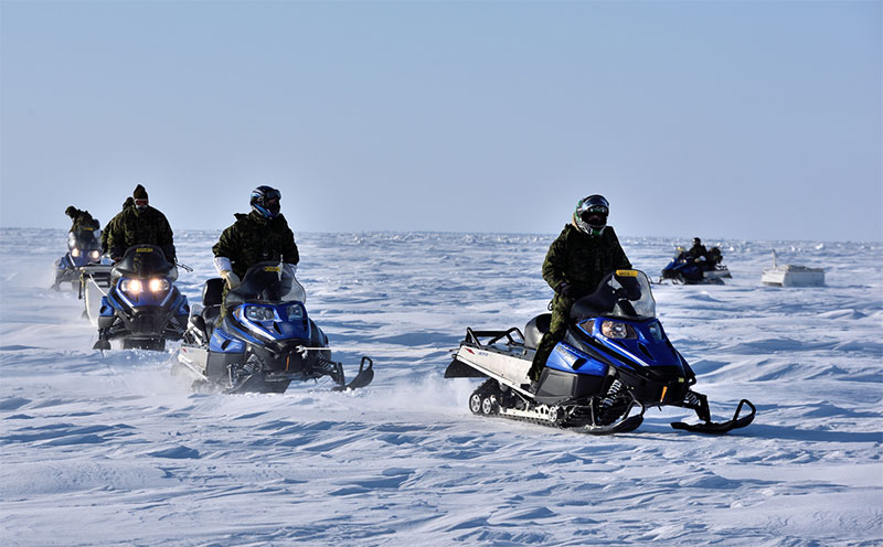 Soldiers on snowmobiles