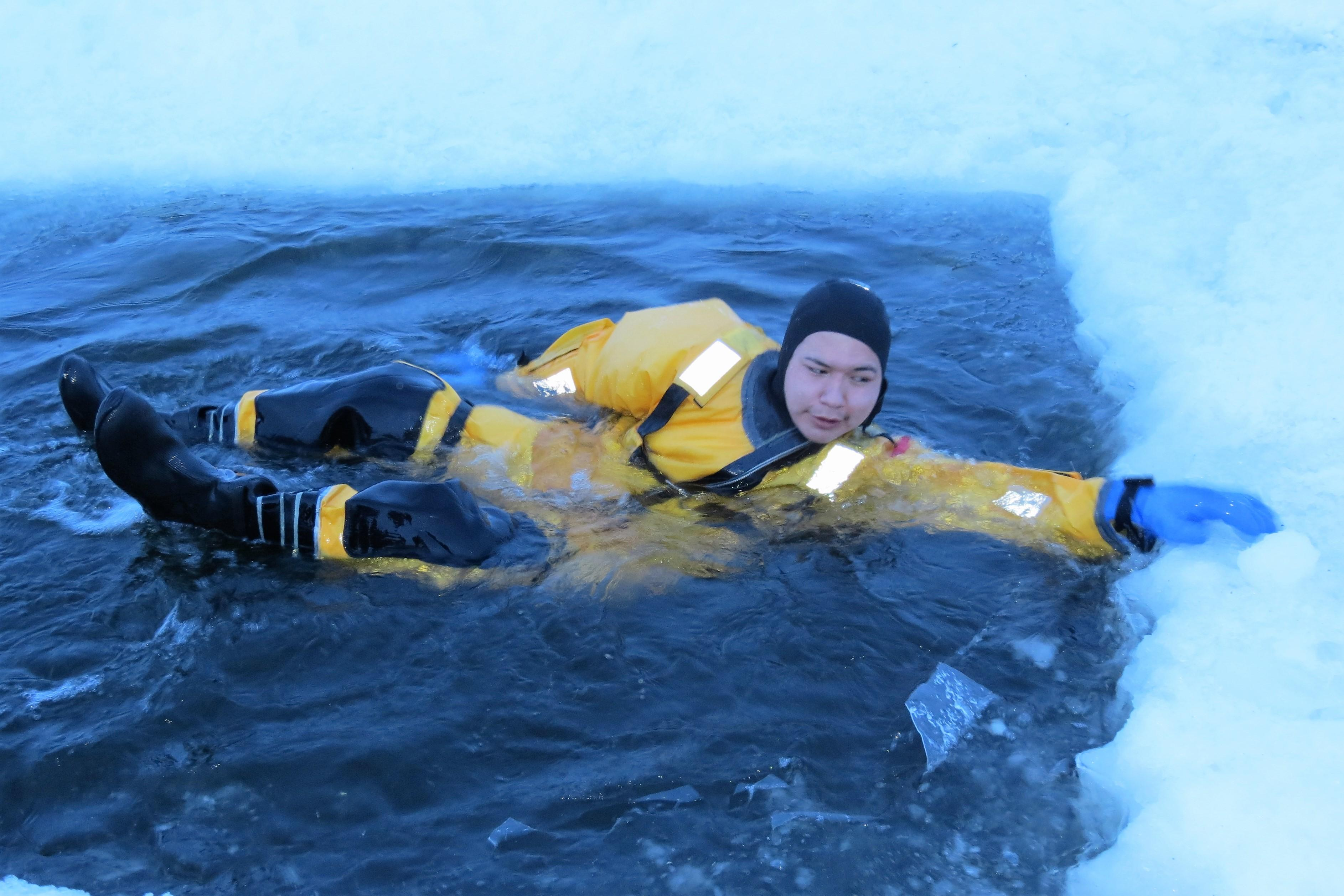 Sachigo Lake First Nation's Ranger Harry McKay wears an immersion suit during an ice rescue training session in Sandy Lake First Nation, Ontario on February 5, 2017.