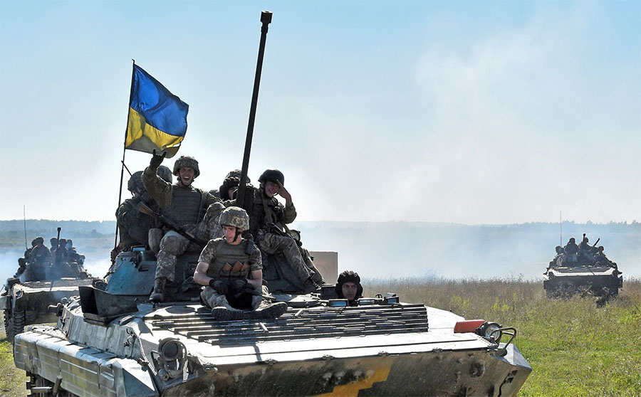 Ukrainian trainees are transported by an BMP-2 infantry fighting vehicle