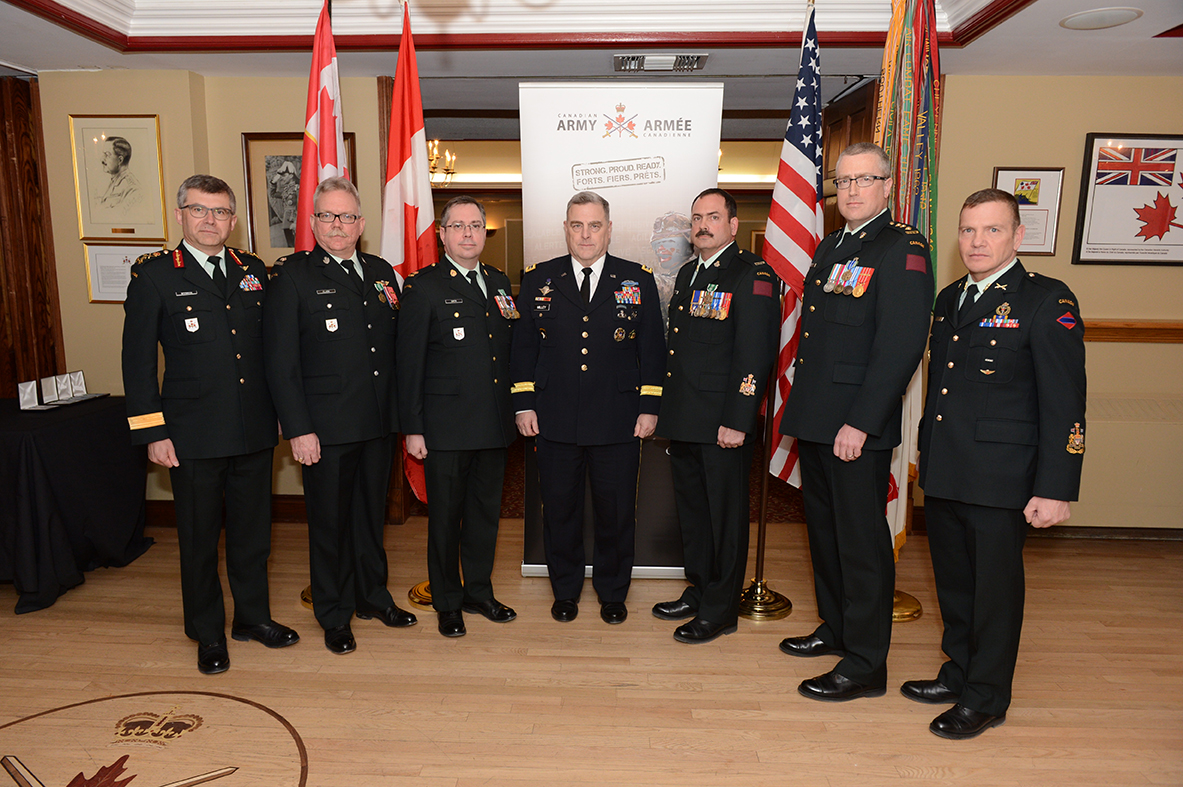 General Mark Milley, Chief of Staff, United States Army (centre), recognizes four Canadian Army members with U.S. Army Commendation and Achievement medals at the Army Officers' Mess in Ottawa, Ontario on March 6, 2017. 