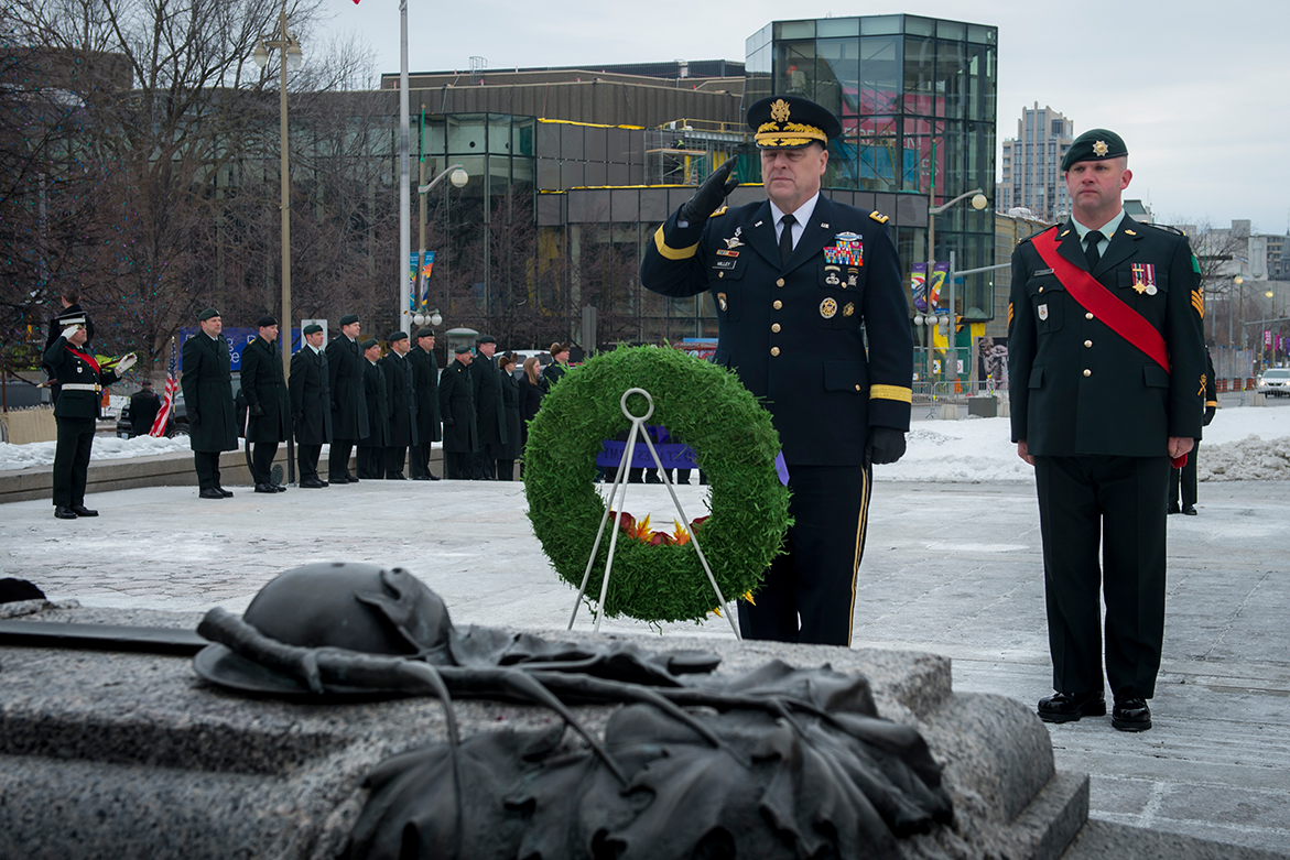 General Mark Milley, Chief of Staff, United States Army (centre) salutes after laying a wreath during a ceremony held at the National War Memorial in Ottawa, Ontario, on March 6, 2017. 