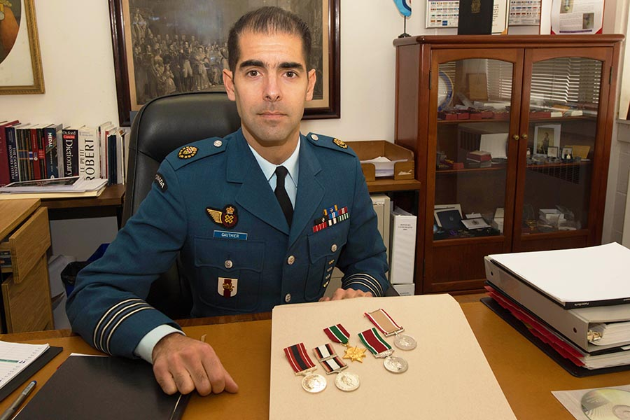 Officer showing medals
