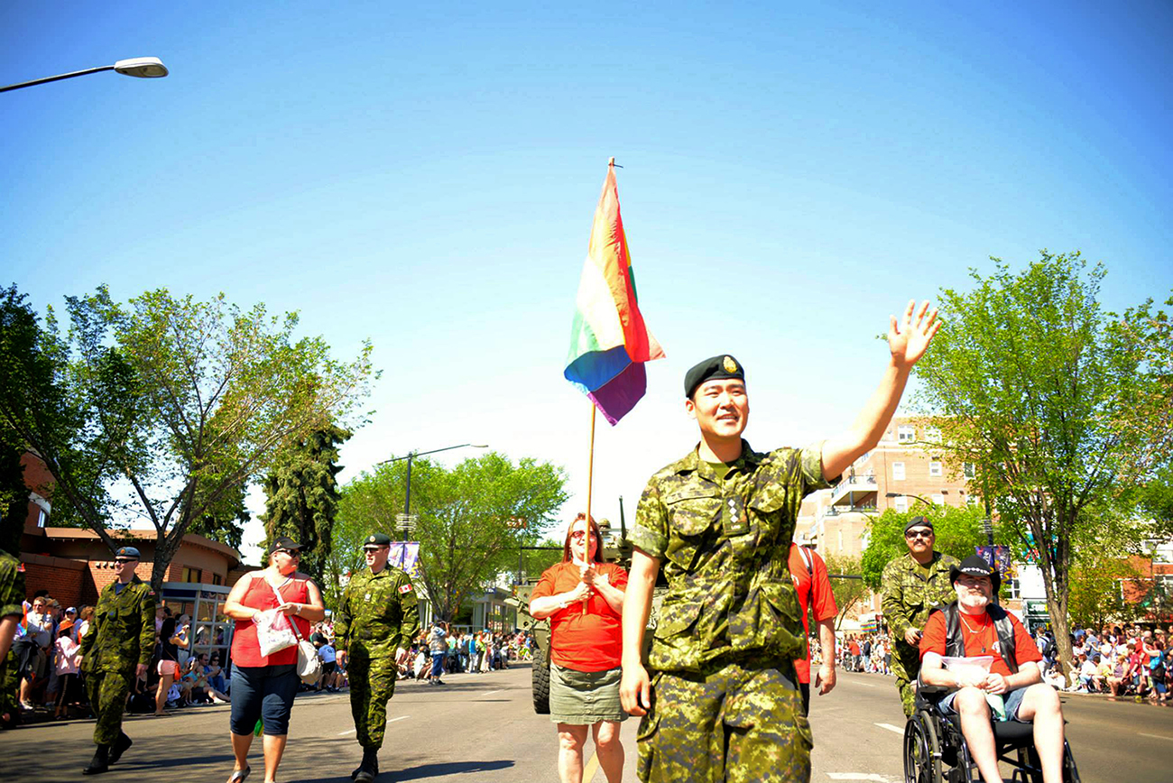 "Captain Matthew Hou in the 2013 Pride Parade in Edmonton, Alberta. Capt Hou organized the first Canadian Armed Forces entry in an Albertan pride parade. ""I was very proud of all the volunteers and their families who made it out to the event,"" he said. 