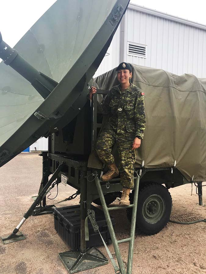 Master Corporal Nikki Gregg, an Army Communication and Information Systems Specialist, prepares to deploy a satellite communications system by performing a daily inspection of the trailer and dish at Canadian Forces Base Petawawa, Ontario on May 4, 2017.