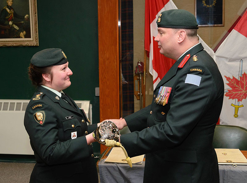 Lieutenant-Colonel Jackie Janzen receives the 38 Signal Regiment sword of command from Colonel Geoff Abthorpe, Commander 38 Canadian Brigade Group in Winnipeg, Manitoba on January 14, 2017. 