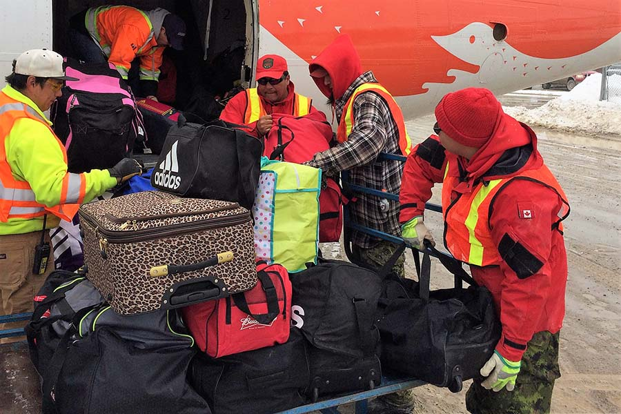 Canadian Rangers load town residents' baggage on to an evacuation aircraft at Kashechewan Airport in Kashechewan, Ontario, on April 16th, 2017.