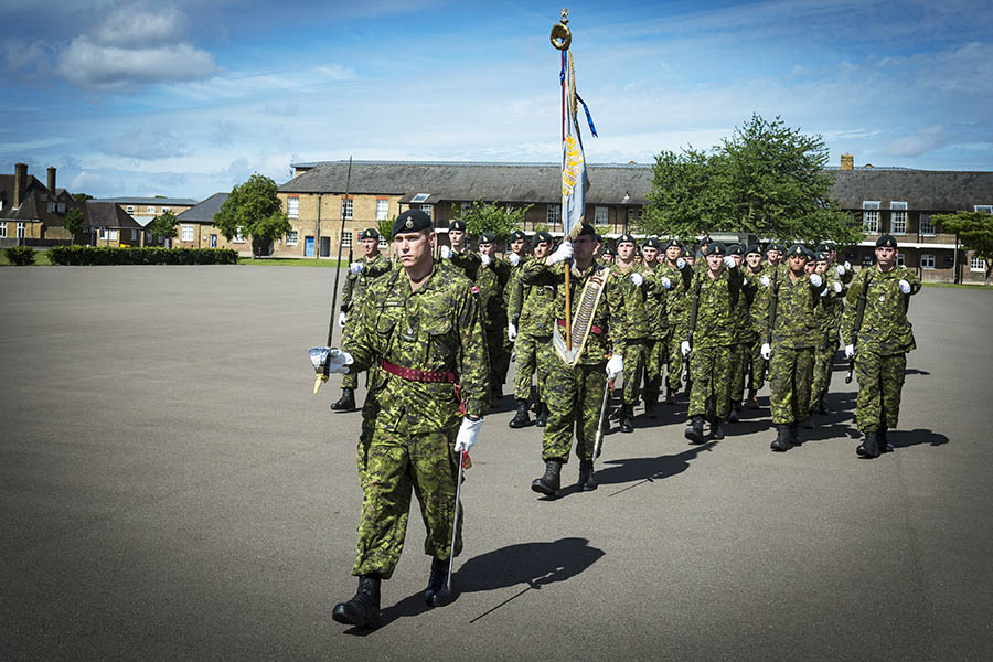 Major Jason Hudson, Officer Commanding, Alpha Company, 2 Princess Patricia's Canadian Light Infantry, leads his troops during a drill rehearsal in Hounslow, United Kingdom, on June 10, 2017.